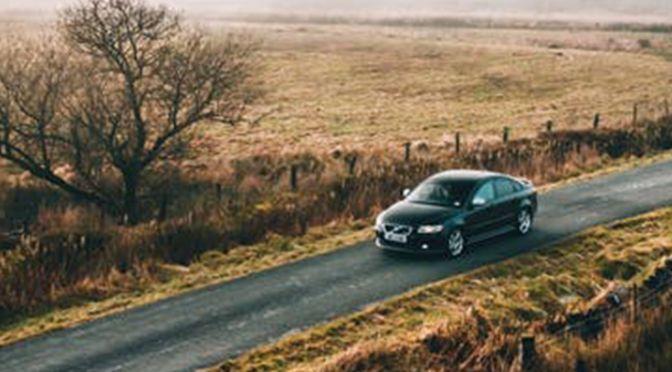 A car driving through a rural setting