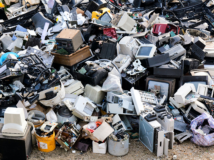 Electronic waste piles up at a landfill