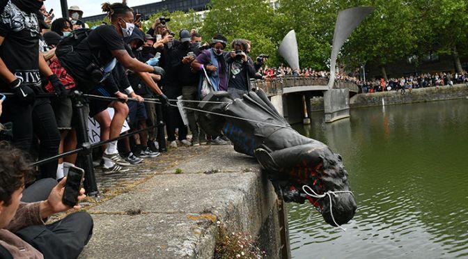 Protestors in Bristol throw the Edward Colston statue into the river