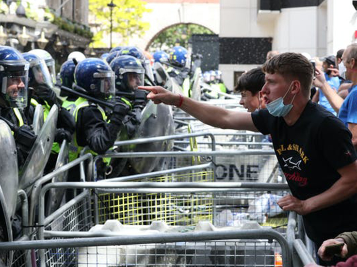 'Football Lads Alliance' and other protesters clash with police in London, June 13 2020. Jonathan Brady/PA Wire/PA Images