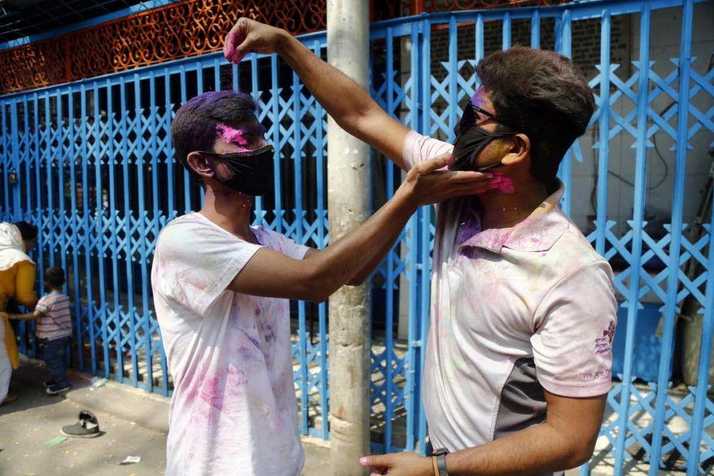 Celebrating Holi festival in medical face masks in Dhaka, Bangladesh, 9 March 2020. Monirul Alam/EPA-EFE