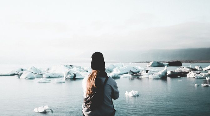 Woman watching ice on a body of water