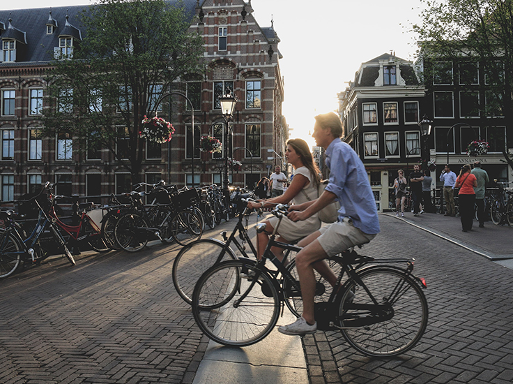 Couple riding a bike in the city