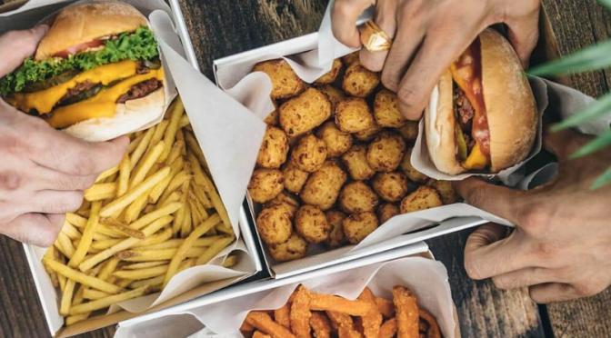 Burger, fries and tater tots at Neat Burger