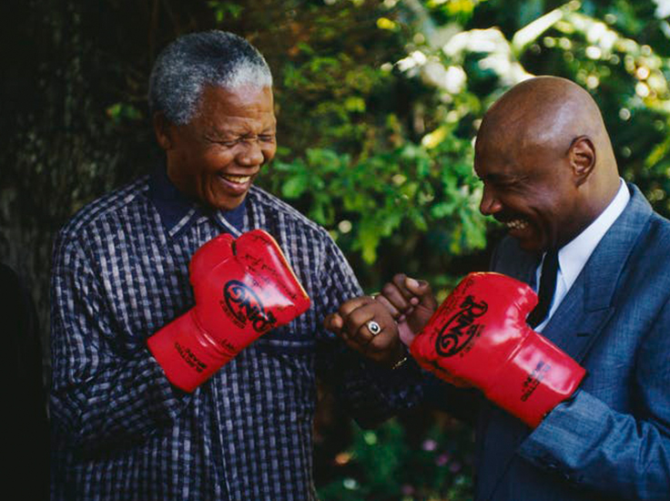 Former South African President Nelson Mandela with former American world boxing champion Marvin Hagler. The undated photo was taken after Mandela's release. Louise Gubb/GettyImages