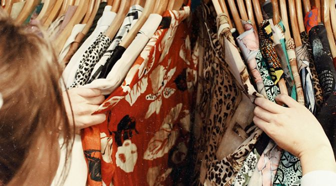 Woman browsing secondhand clothes