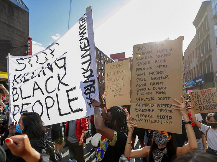 Protesters with signs. Justin Lane/EPA