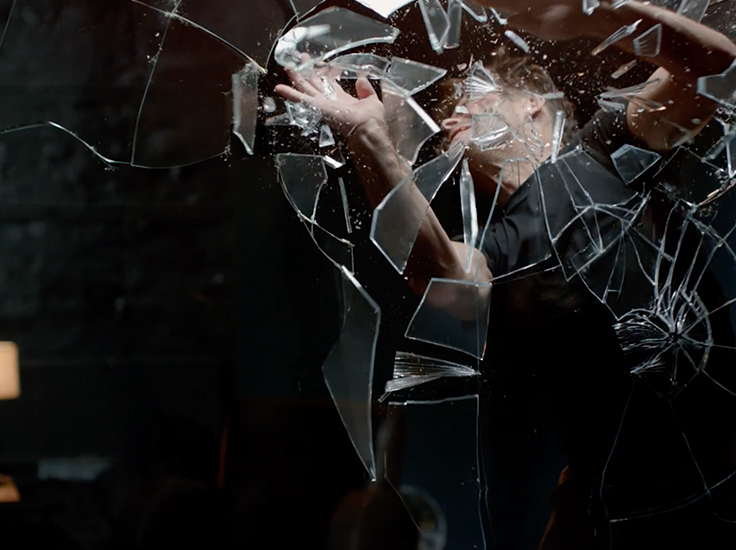 Alex smashing through glass in Smashed, a short film by Tim Pope