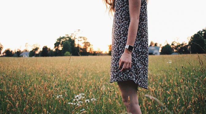 Woman in a sundress in a field