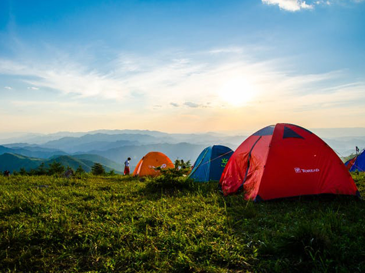 tents overlooking mountain view