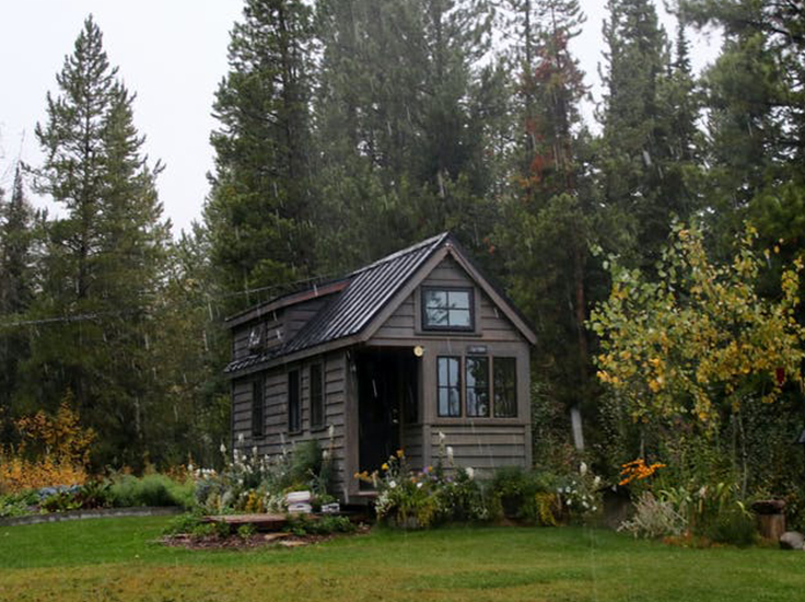 Tiny house in garden landscape